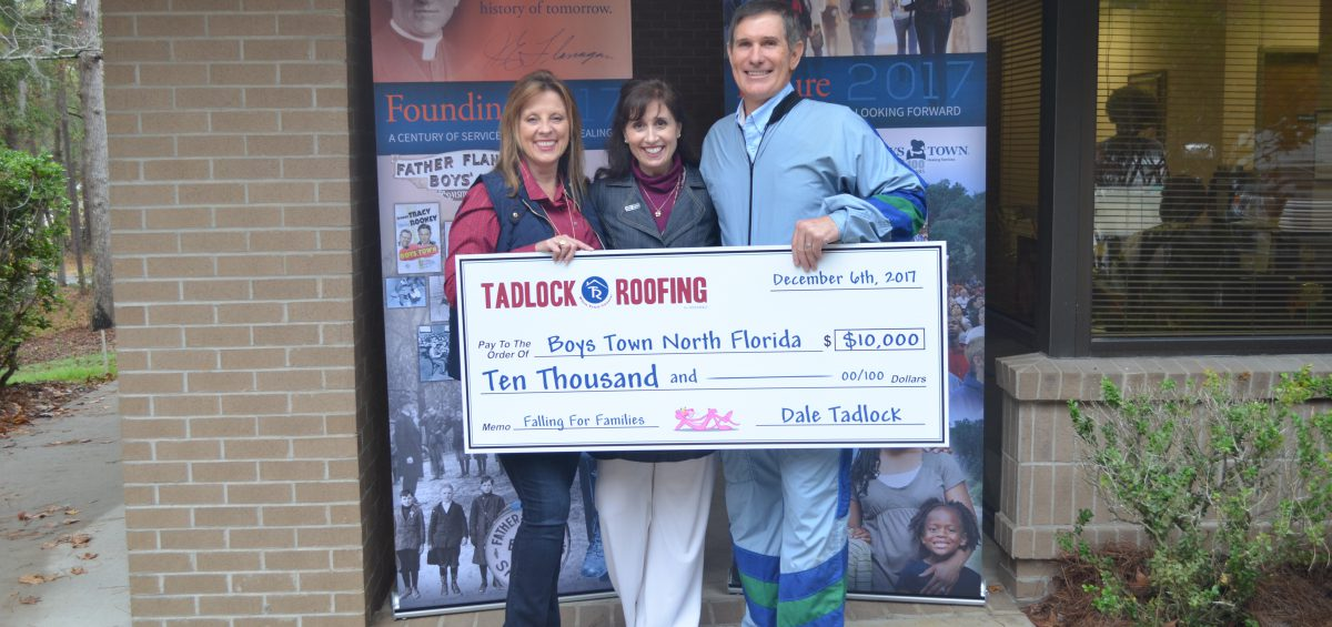 Dale and Pamela Tadlock Present Boys Town North Florida Development Director Dena Strickland with $10,000 check.